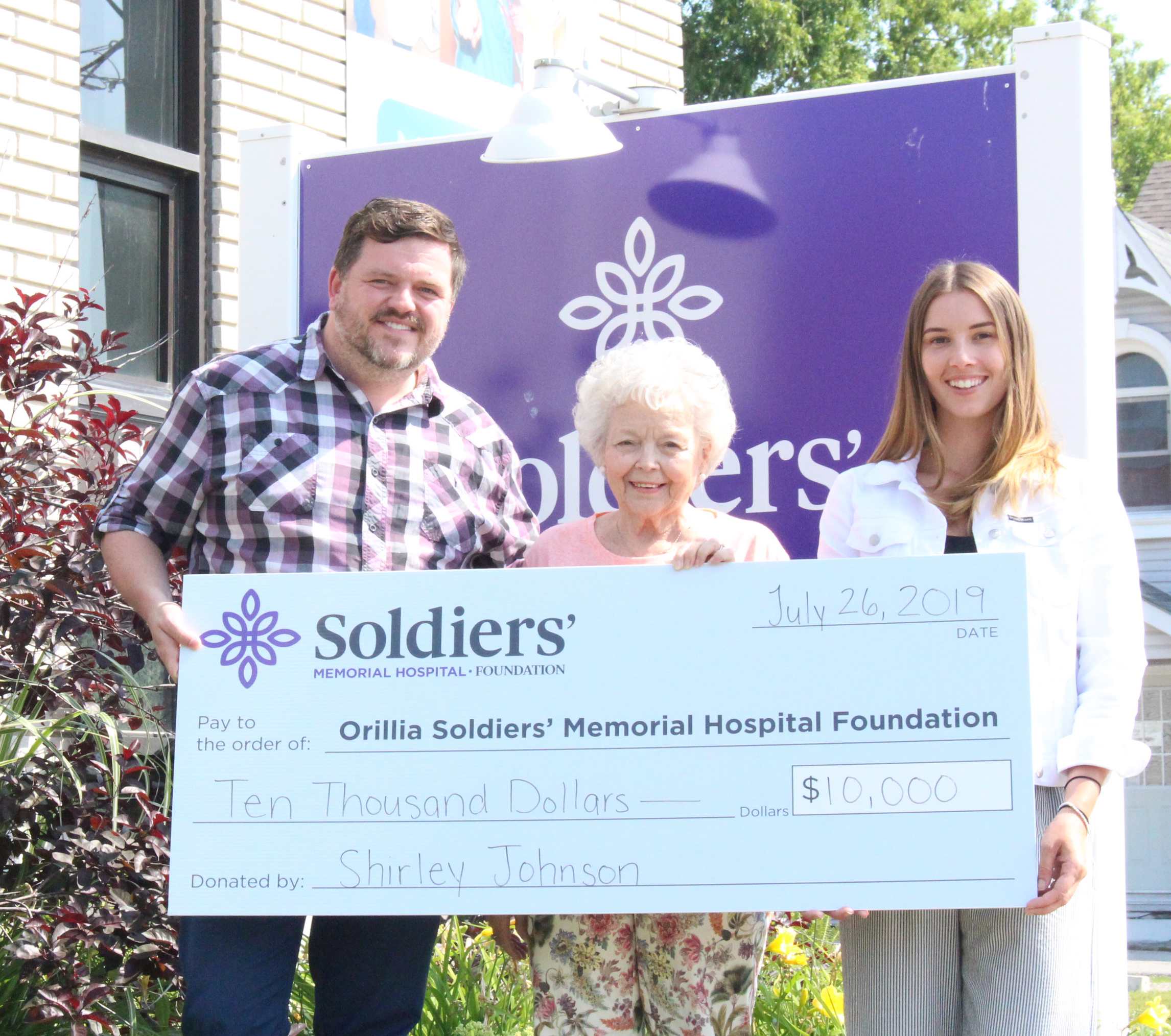 Shirley Johnson (centre) presents the Orillia Soldiers' Memorial Hospital Foundation with a cheque for $10,000 to refresh the Birthing and New Families Services Family Waiting Room to Mark Riczu, OSMH Foundation Executive Director (left) and Brittany Wilson, OSMH Foundation Development Officer, Major Gifts.