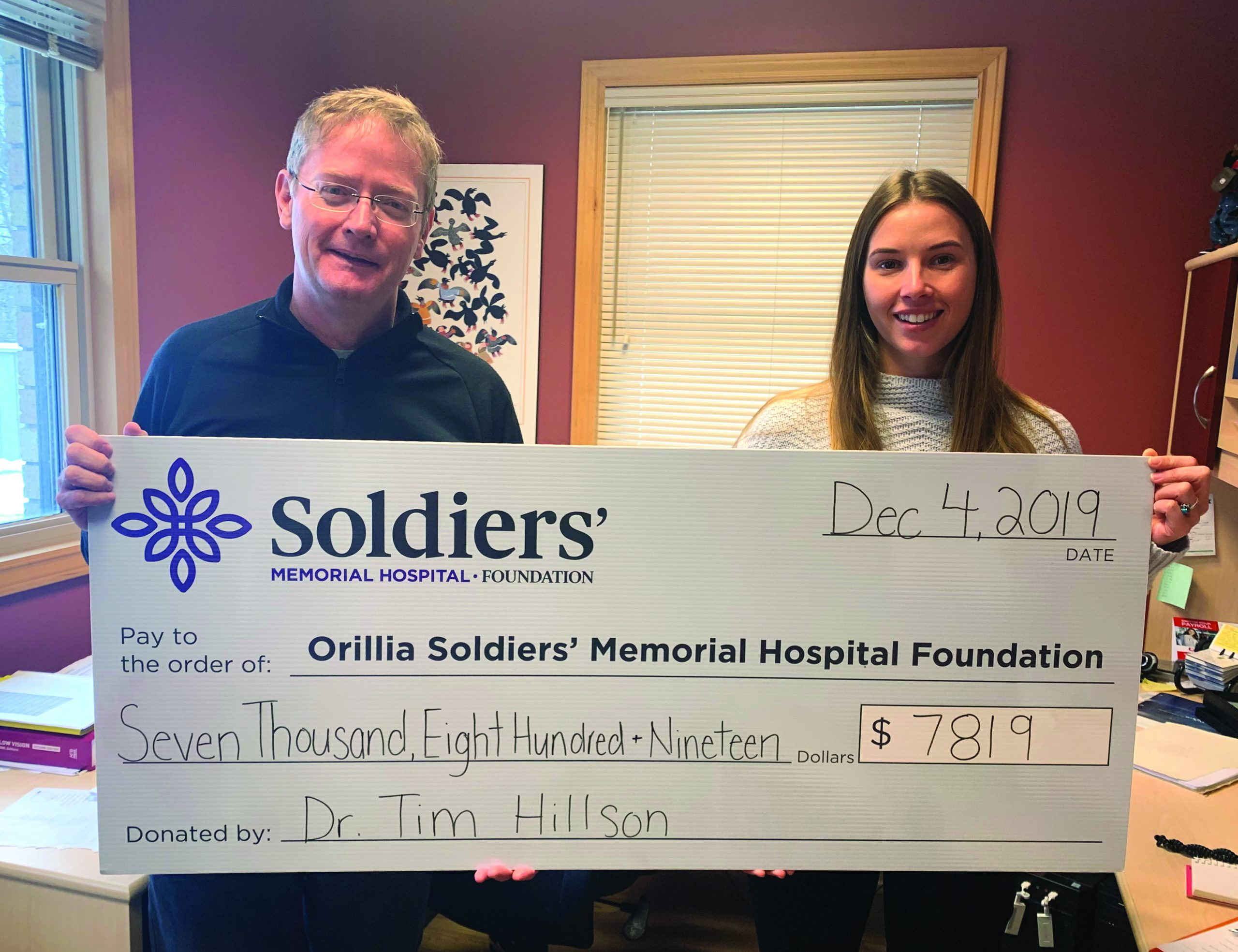 Dr. Tim Hillson (left) presents a cheque for $7,819 to Brittany Wilson, OSMH Foundation Development Officer, the proceeds of Cure for the Common Comedy show that he organized this past October.