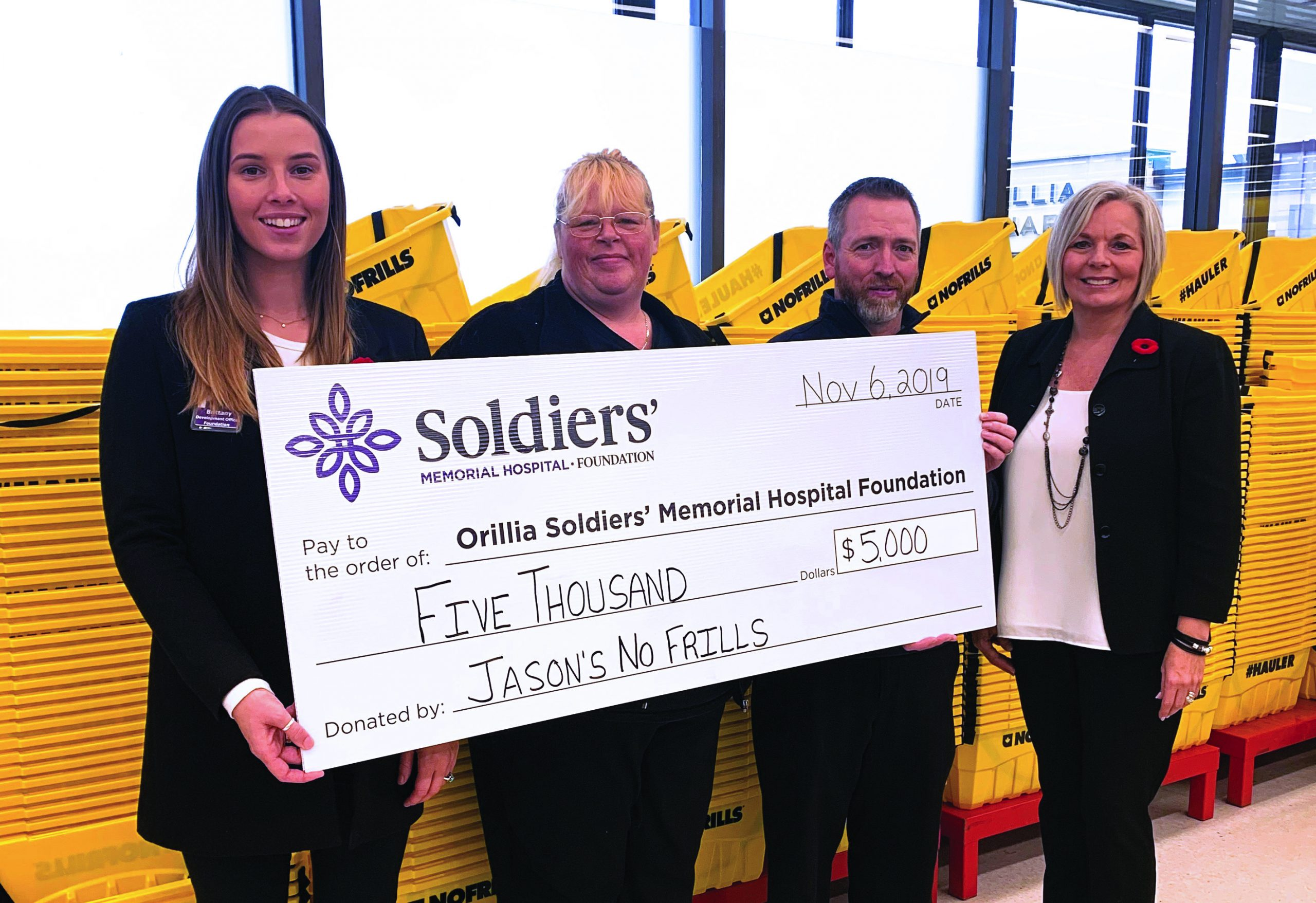 Lisa Steeves (centre left), Jason's No Frills Front End Supervisor and Jason King (centre right), Jason's No Frills Owner present a cheque for $5,000 to Brittany Wilson (left), OSMH Foundation Development Officer and Lisa Wanamaker OSMH Foundation Development Officer.