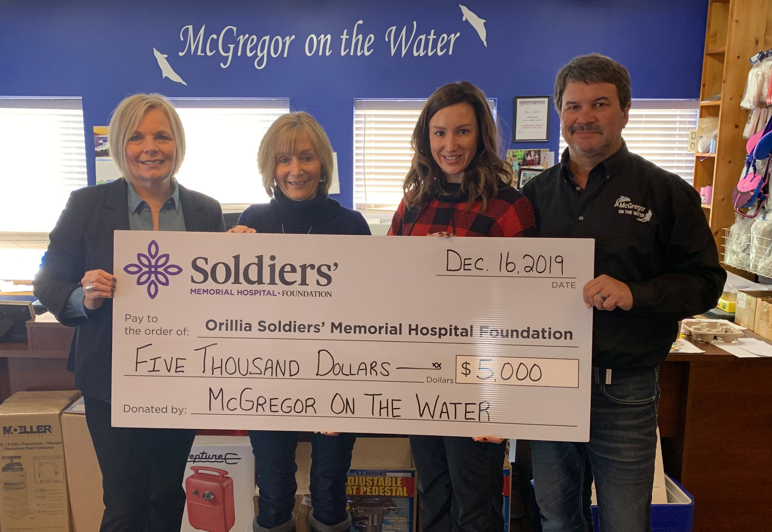(L-R) Lisa Wanamaker, OSMH Foundation Development Officer is presented with a cheque for $5,000, the proceeds from the 19th annual McGregor on the Water Customer Appreciation BBQ, from Linda Csumrik, Vice President, Erin Shaw, Office and Dock Crew Member, and Doug Csumrik, President of McGregor on the Water.