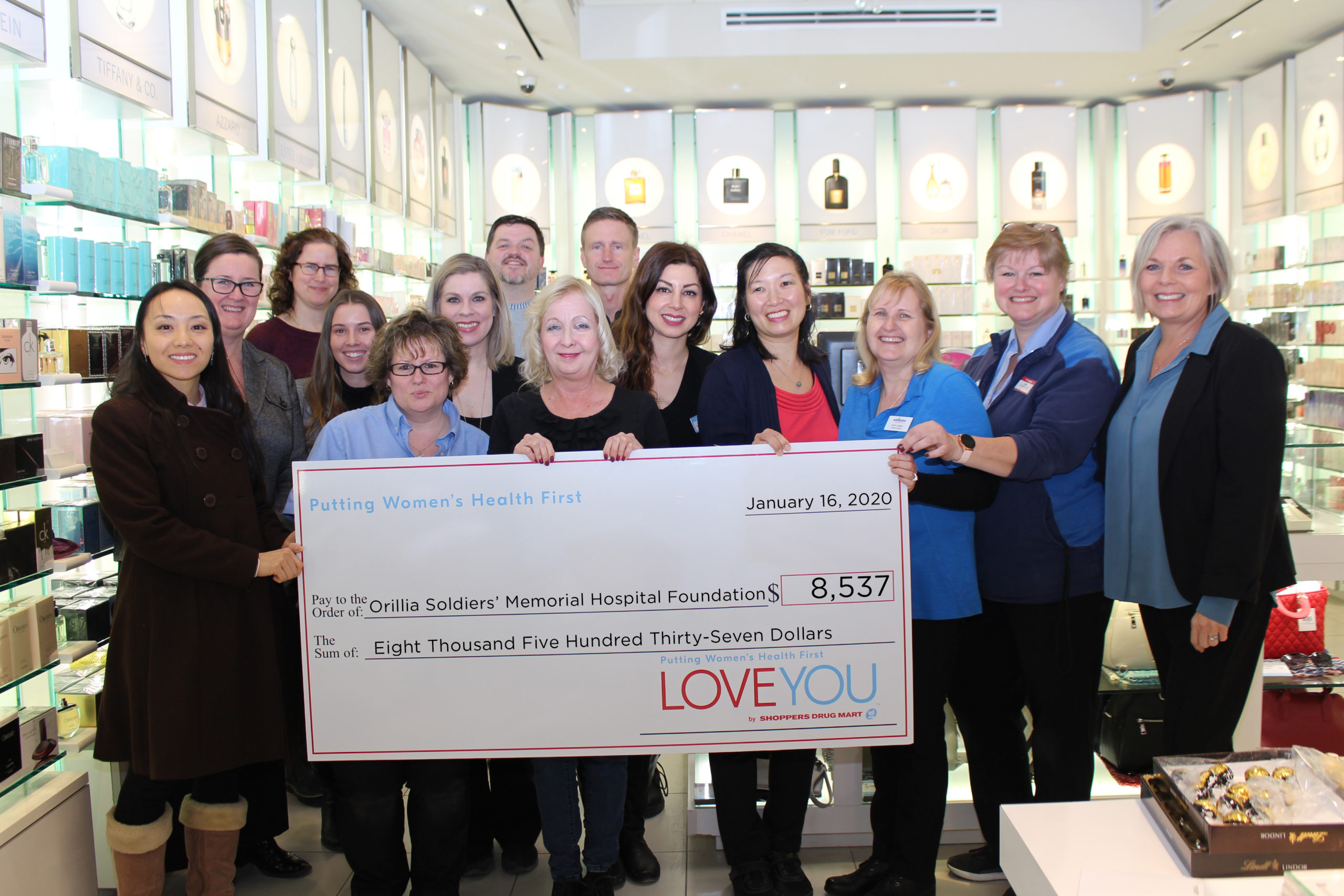 Shoppers Drug Mart owners and staff present a cheque for $8,537 to representatives of the Orillia Soldiers' Memorial Hospital Foundation to support Women's Health Programs at the Hospital.
